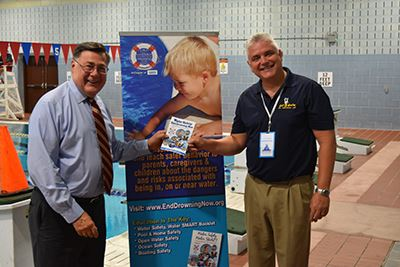 Supervisor Ed Romaine and Bobby Hazen in front of pool