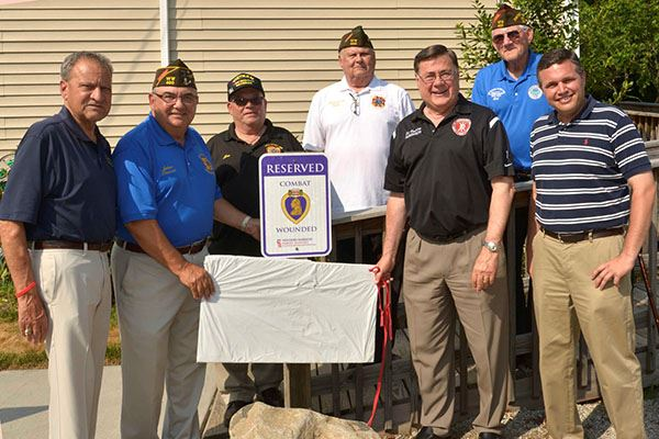 Mayor with group at new Purple Heart Parking Spot