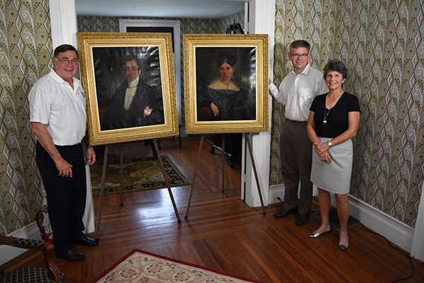Supervisor Romaine and Town Historian with Historic Portraits