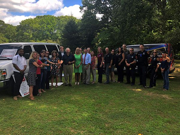 Group Photo in Front of Donated Hope House Van