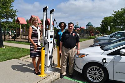 Councilwoman Bonner, Councilwoman Cartright and Supervisor Romaine in front of charging station