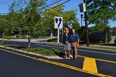 Highway Superintendent Losquadro and Councilwoman Bonner Standing on Newly Paved Roads