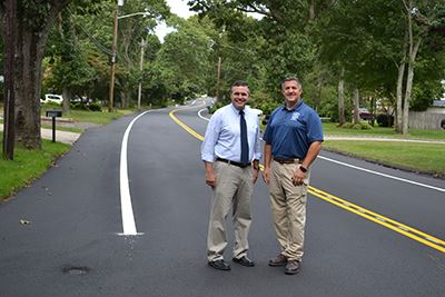 Highway Superintendent Losquadro and Councilman LaValle Standing on Paved Road