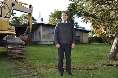 Councilman Panico in front of Happy Acres Drive Demolition