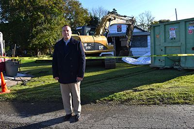 Councilman Panico in front of Lincoln Drive Demolition