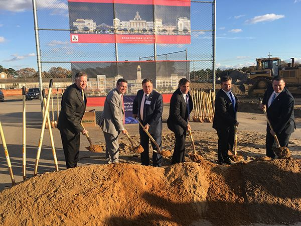 Six business men with shovels at groundbreaking ceremony