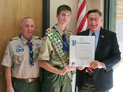 Scoutmaster Ed Champ, Eagle Scout and Supervisor Ed Romaine