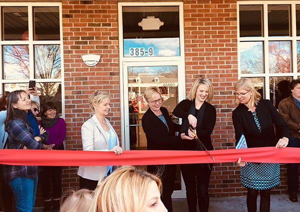 Women at ribbon cutting at business