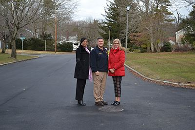 Group Photo Standing on Newly Paved Road