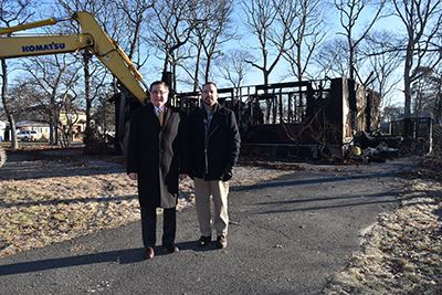 Councilman Panico and Supervisor Romaine Standing in Front of Burned House