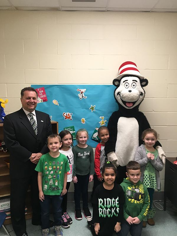 Councilman with students and a Cat in the Hat mascot