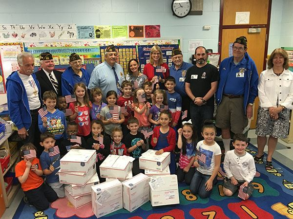 Veterans with children and boxes to send