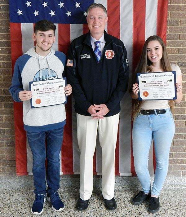 Two students holding awards with Councilman