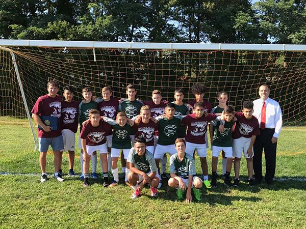 Image of youth boys soccer team in front of goal