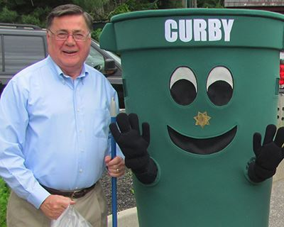 Supervisor Romaine with Curby can
