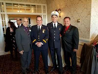 Pictured (left to right) are Assemblyman Joe DeStefano; Bellport Fire Commissioner Greg Behl; 1st As