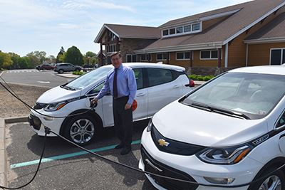 Supervisor Romaine plugging in new Electric Vehicles
