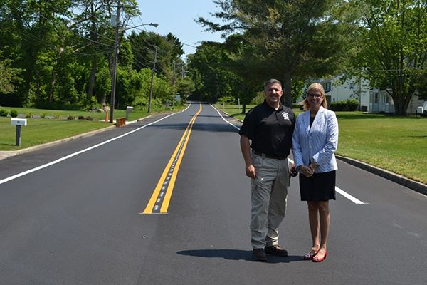 Superintendent Losquadro and Councilwoman Bonner Standing on Newly Paved Road