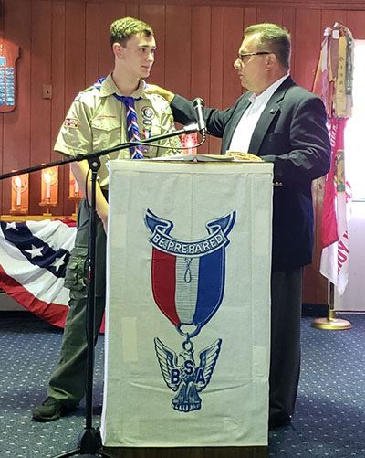 Eagle Scout and Councilman Loguercio at podium