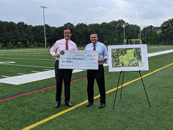 Senator Flanagan and Councilman LaValle holding check at the Selden Park