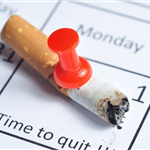 Cigarette pinned to a calendar with