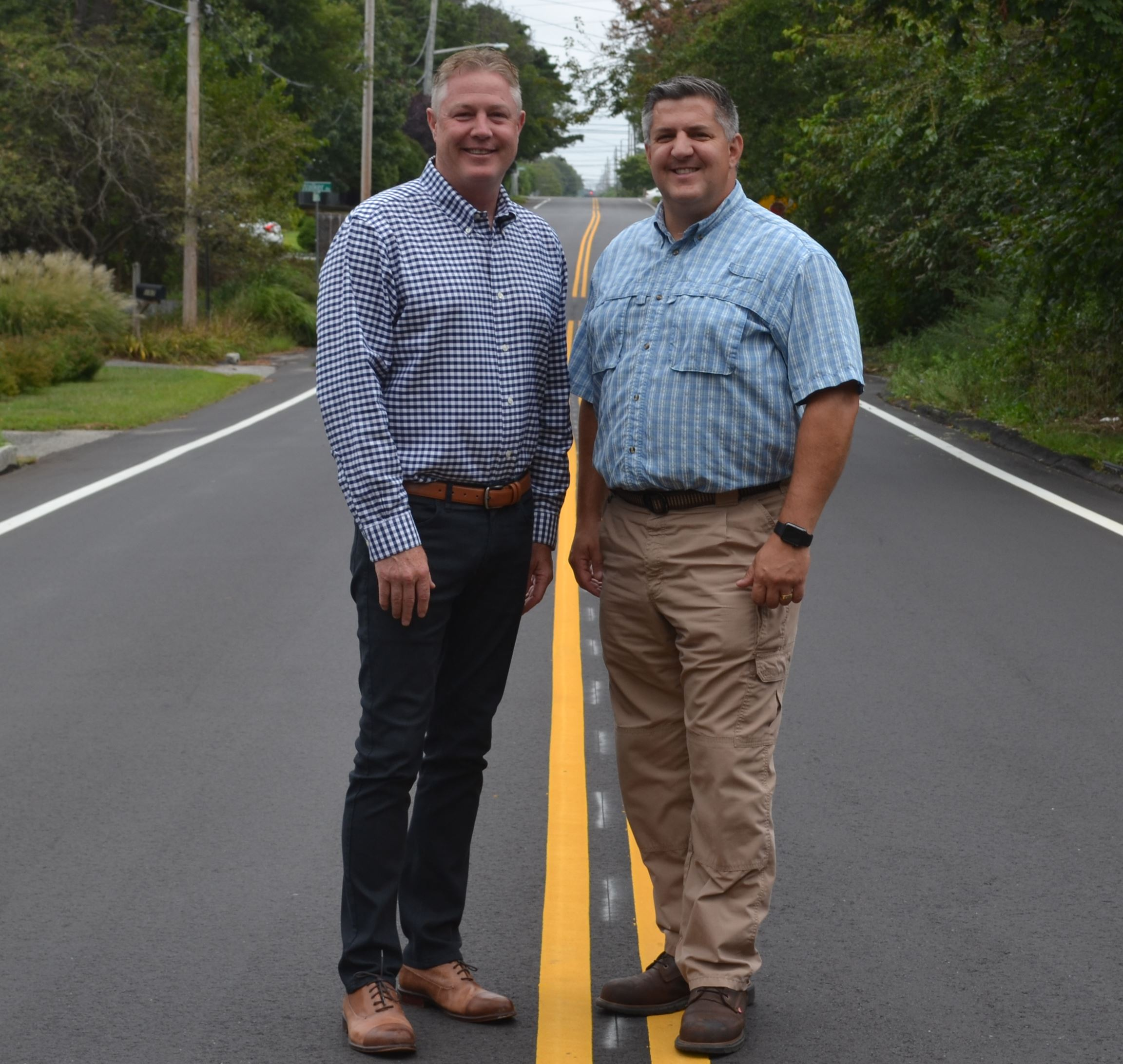 Superintendent Losquadro and Councilman Foley Standing on Newly Paved Road