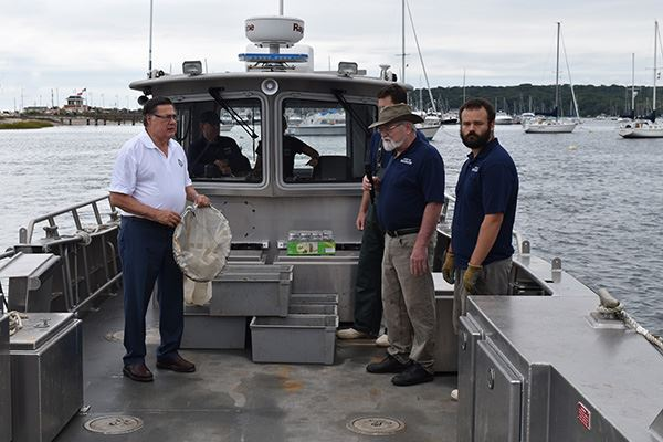 Supervisor Romaine on Boat  with Environmental employees