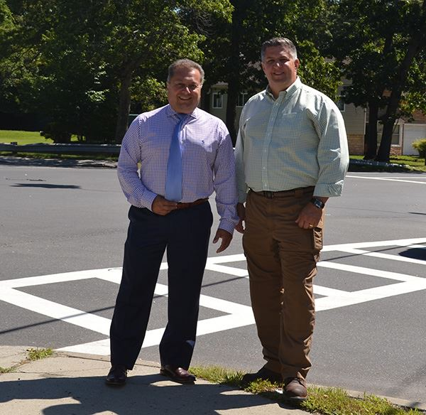 Councilman Loguercio and Highway Superintendent Losquadro standing on Granny Road