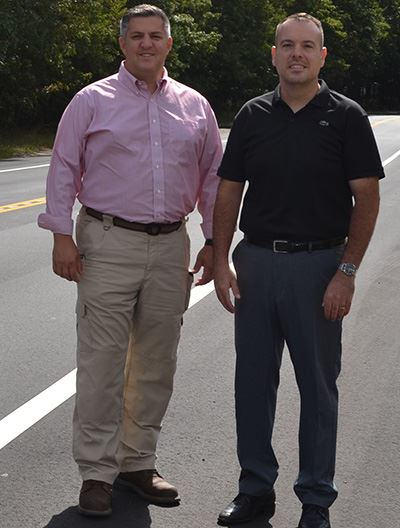 Elected Officials Standing on Newly Paved Road