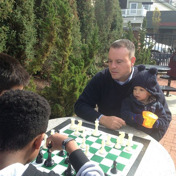 Councilman Panico playing Chess at festival