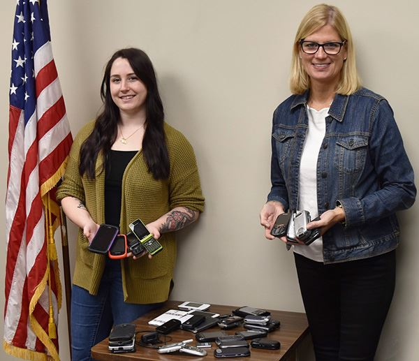 Councilwoman Bonner and the Town's Veterans Officer holding donated phones