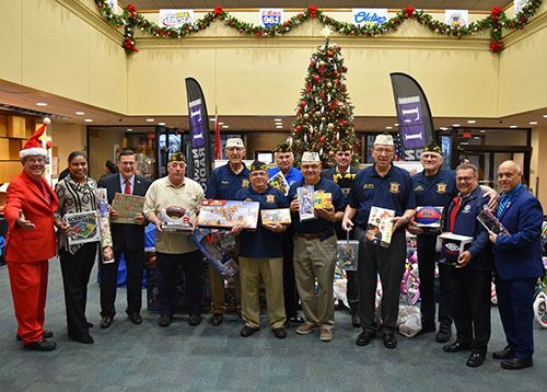 Brookhaven's Toy Drive with a group photo of government officials and residents