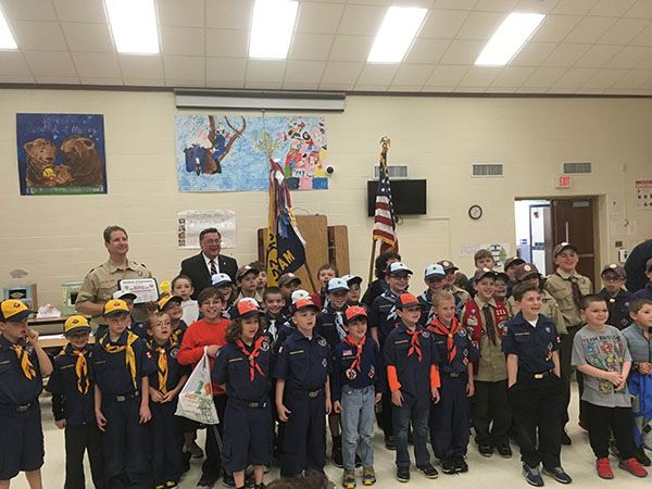 Image of cub scouts in uniform in group photo