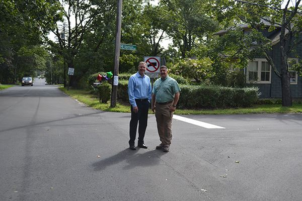 Two men standing on a road