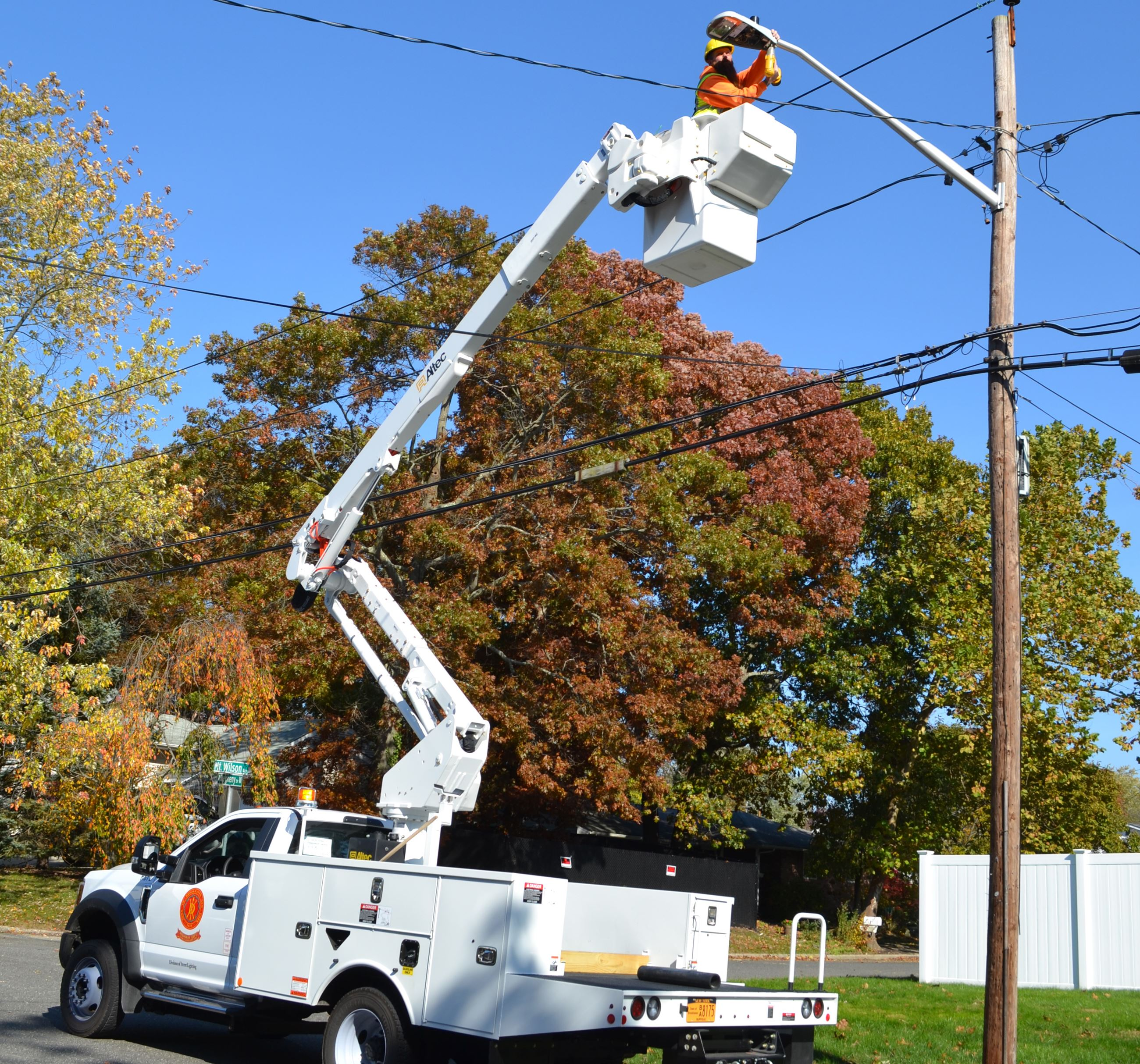 Brookhaven Highway Department employees replace Town streetlight fixture
