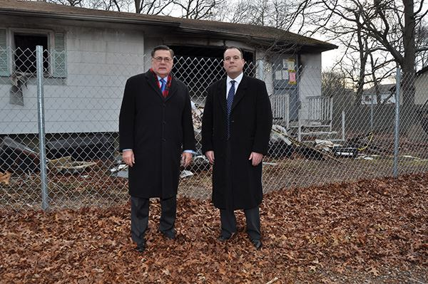 Two men stand outside home to be demolished