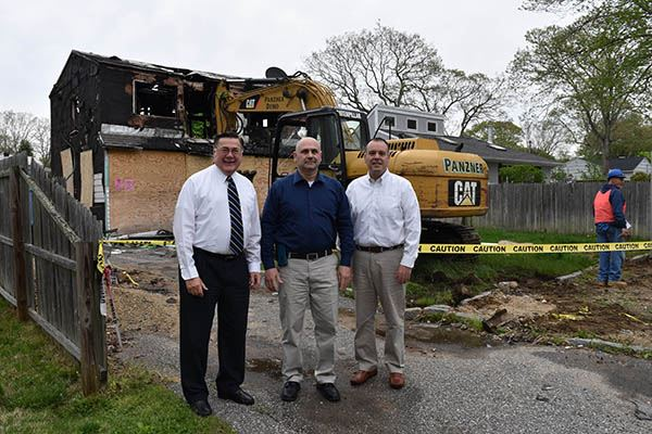 Three men in front of home to be demolished