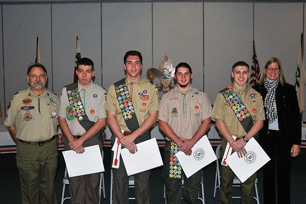 Four boy scouts with awards in hands