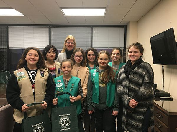 Girl scout troop smilng for camera