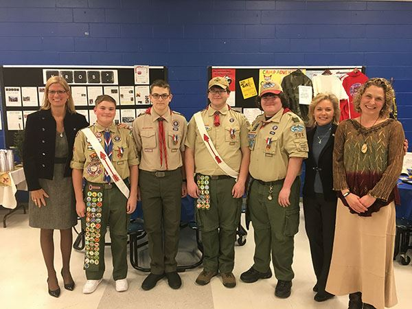 Boy scout troop with adults at event