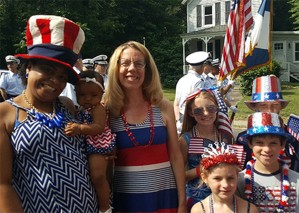 People dressed in red white and blue for Fourth of July