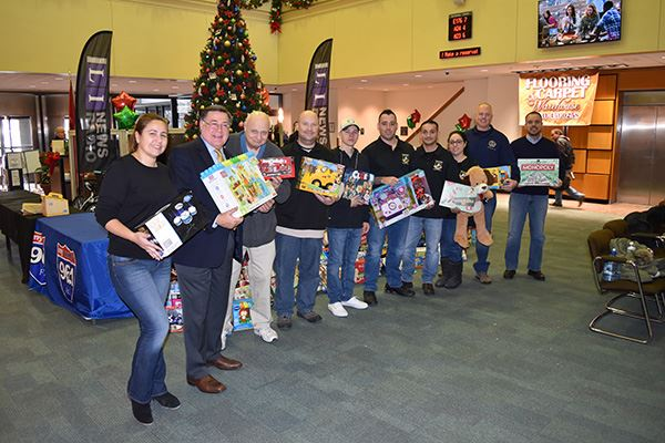 JVC Staff with Toy Donations
