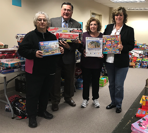 Supervisor Romaine with Donated Toys