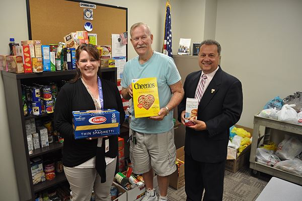 Councilman Loguercio Stands with Food Drive Donations