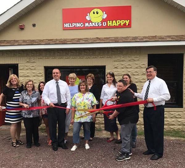 Supervisor Romaine and Councilman Panico Cut Ribbon at New Headquarters of Helping Makes U Happy