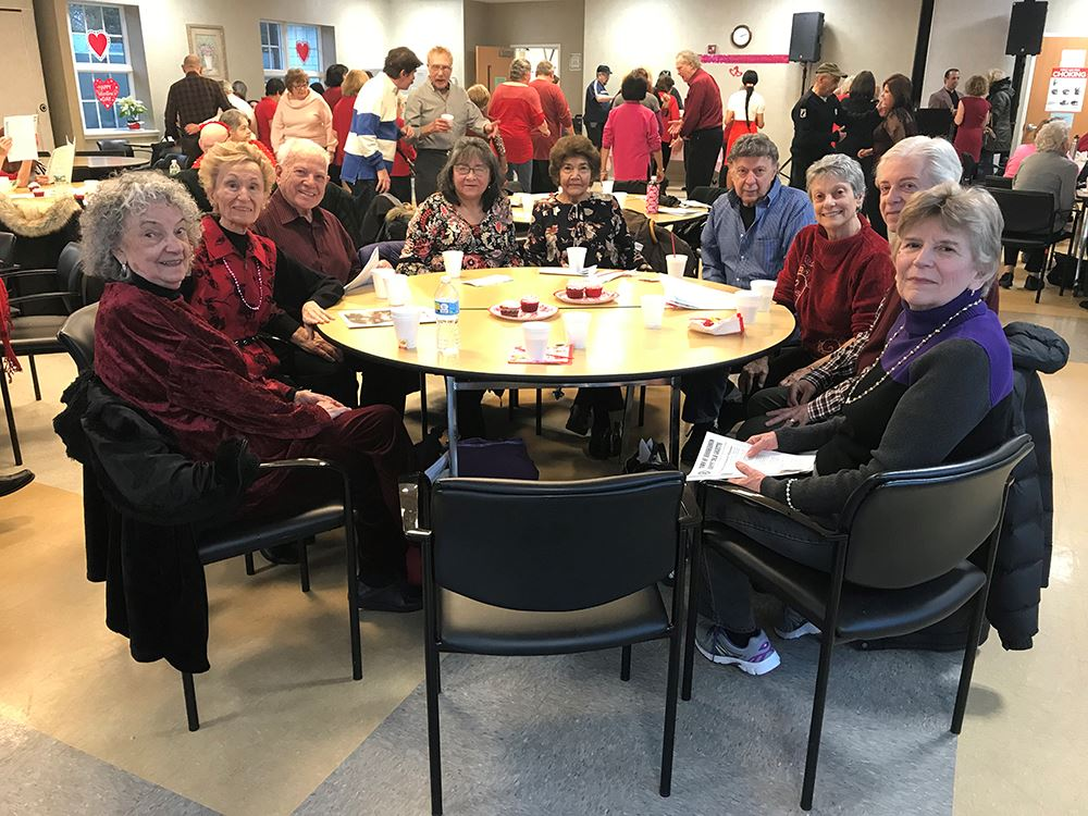 Image of large group of older adults at an indoor event