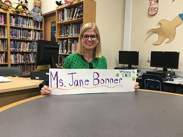 Woman holding sign with Ms. Jane Bonner sign