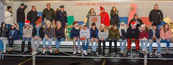 Councilman Loguercio and community members watching the Yaphank Fire Department Christmas Parade
