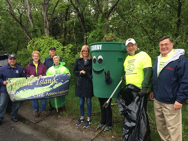 Group of people smiling with Recycling Bin mascot